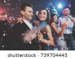 new year party. young couple... | Shutterstock . vector #739704445