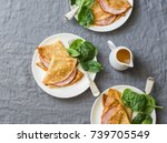 crepes with ham and spinach.... | Shutterstock . vector #739705549