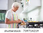 senior woman cooking in the... | Shutterstock . vector #739714219