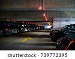 underground parking with cars | Shutterstock . vector #739772395
