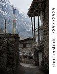 prayer flags and stone built... | Shutterstock . vector #739772929