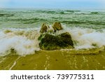 Waves Rushing To Shore Over A...