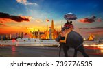 an elephant with tourists at... | Shutterstock . vector #739776535