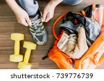 man tying her shoelaces with... | Shutterstock . vector #739776739
