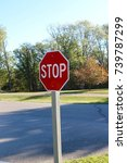 the red stop sign on the wooden ... | Shutterstock . vector #739787299
