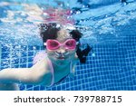 funny asian baby girl swimming... | Shutterstock . vector #739788715