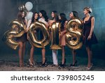 celebrating new year party.... | Shutterstock . vector #739805245