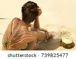 woman with coconut drink under... | Shutterstock . vector #739825477
