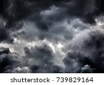 dark and dramatic storm clouds... | Shutterstock . vector #739829164