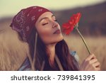 beautiful young woman smells a...   Shutterstock . vector #739841395
