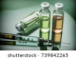 several vials and syringe in... | Shutterstock . vector #739842265