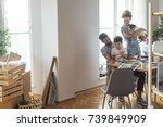 happy caucasian family moving...   Shutterstock . vector #739849909
