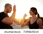 a young fit woman high fiving... | Shutterstock . vector #739865014