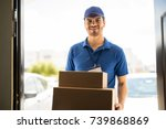 hispanic young delivery man... | Shutterstock . vector #739868869