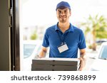 handsome young man delivering a ... | Shutterstock . vector #739868899