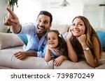 happy family watching... | Shutterstock . vector #739870249