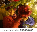 young under a christmas tree on ... | Shutterstock . vector #739880485
