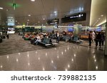 Small photo of Hamad International Airport, Doha, Qatar - Oct 21, 2017: People waiting to board their flight at their gates