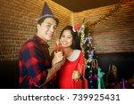 Portrait Of Happy Asian Couple...