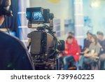 cameraman shooting in studio | Shutterstock . vector #739960225