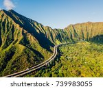 Small photo of Green cliffs and mountains on the island of Oahu, Hawaii with the world famous Haiku stairs or the stairs to heaven. Ho'omaluhia Botanical Garden in Kaneohe