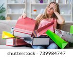 Young Woman With Shopping Bags...