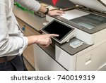 man copying paper from... | Shutterstock . vector #740019319