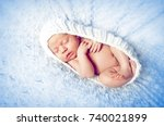 Small photo of A lone, newborn baby in a sleeping cocoon. Concept Stop abortion Take care of children