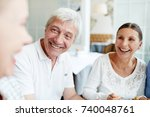laughing mature man and woman... | Shutterstock . vector #740048761