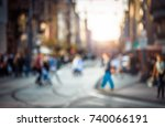 blurred people walking through... | Shutterstock . vector #740066191