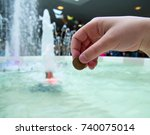a man tosses a coin into a...