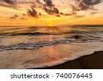 ocean sunset is an ocean sunset ... | Shutterstock . vector #740076445