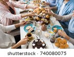 guests by festive table helping ... | Shutterstock . vector #740080075