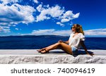 carefree tanned woman enjoys... | Shutterstock . vector #740094619