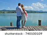 a couple on the wooden jetty at ... | Shutterstock . vector #740100109