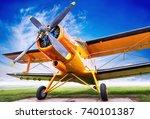 Biplane Against A Cloudy Sky