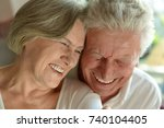 happy elderly couple embracing | Shutterstock . vector #740104405