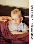 Small photo of the boy with the handkerchief, in pateli with a cold, sneezes, coughs. concept on the topic of acute respiratory diseases, flu, colds
