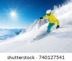 skier skiing downhill during... | Shutterstock . vector #740127541