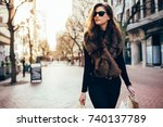 young woman with shopping bags... | Shutterstock . vector #740137789