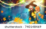 halloween witch with a carved... | Shutterstock . vector #740148469