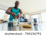 man preparing milk shake in... | Shutterstock . vector #740156791
