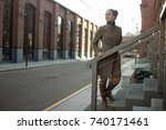 A Young Woman In A Beige Coat ...