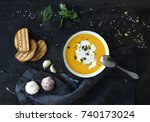 pumpkin soup with cream  seeds  ... | Shutterstock . vector #740173024