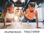 two sporty girls doing push ups ... | Shutterstock . vector #740173909