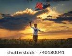 boy launch a kite in the field... | Shutterstock . vector #740180041