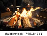 people roasting marshmallows... | Shutterstock . vector #740184361