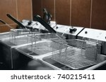 fryer for potatoes with boiling ... | Shutterstock . vector #740215411