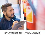 man inspecting fire... | Shutterstock . vector #740220025