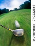 Small photo of Golf club hitting ball on golf course